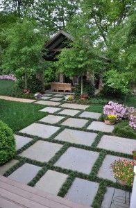 Garden Ideas. Stone Paver Garden Ideas. The grass between the pavers is Dwarf Mondo Grass. Ophiopogon japonicus 'Nana'. #Garden #GardenIdeas #Pavers The Collins Group.