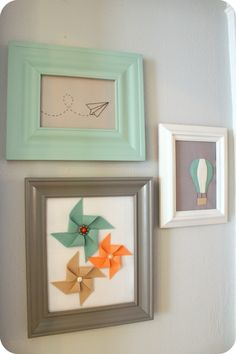 Wall art, pinwheels, hot air balloon, paper air plane, in gray, white, teal.