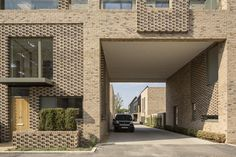 Built on the former Clay Farm site, Abode at Great Kneighton is a key part of a major new housing and mixed-use development in South Cambridge. Mixed Use Development, Arch House, White Wallpaper, Garage Design, Brickwork, Future House, Cambridge, Interior Design, Architecture