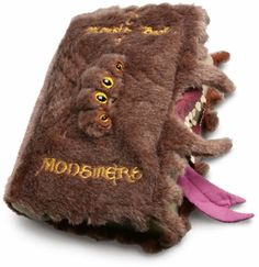 """Pull the tongue on the Harry Potter Book of Monsters Plush, and the book will """"magically"""" vibrate – no batteries required. Plus, its pretty damn big at 8″ wide. It's different, that's for sure – but ..."""