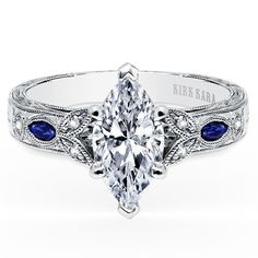 "Picture of Kirk Kara ""Dahlia "" 18K White Gold Marquise Cut Diamond Engagement Ring Crafted with 0.12 Carats of Diamonds and 0.22 carats of Marquise Cut Blue Sapphires."
