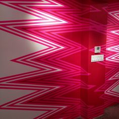 a little paint & colored tape make for a most excellent wall.