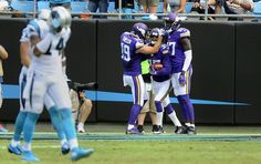 Minnesota Vikings cornerback Marcus Sherels (35) is congratulated by wide receiver Adam Thielen (19) after returning a punt for a touchdown in the first half at Bank of America Stadium on Sunday, September 25, 2016. The Vikings won, 22-10.