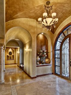Beautiful tuscan entry way with huge art niche (love it), gorgeous lighting, rich warm tones on the ceiling, walls and floor that flow together so well. Also a beautiful door that allows lots of light. Just beautiful. Villa Design, House Design, Foyer Design, Niche Design, Casa Magnolia, Art Niche, Tuscany Decor, Tuscan House, Tuscan Style Homes