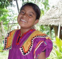 Smiling girl in typical Ngöbe dress; Alto del Valle, Palo Seco, Comarca Ngöbe Buglé, Panamá
