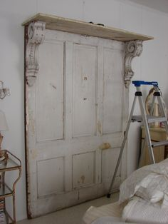headboard made from old doors, corbels