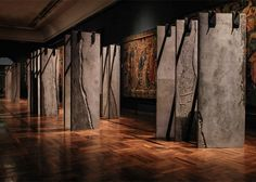 Grafton Architects stands concrete columns in rows to create The Ogham Wall at the V&A Exhibition Stand Design, Exhibition Display, Architecture Wallpaper, Modern Architecture, Ancient Scripts, Concrete Column, Irish Design, V & A Museum, London Design Festival