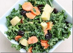 Kale Salad with Carrots, Apples, Raisins, and Creamy Curry Dressing