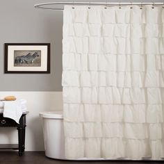 This ivory shower curtain is sure to make your bathroom more beautiful. Featuring an overlapping ruffle design that's modern and feminine, this machine-washable curtain is 72 inches long, and it is made with a microfiber blend for a soft look and feel.