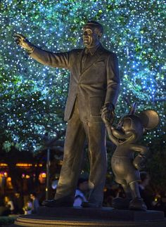 Disney Parks After Dark- Partners statue surrounded by twinkling lights.