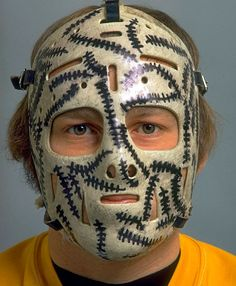 Gerry Cheevers had arguably the most recognizable goalie mask of all time. The Boston Bruins netminder added stitches to his mask every time a puck struck it. (Tony Triolo/SI)