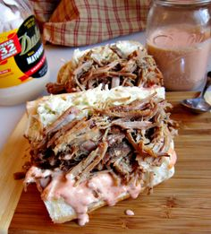 Slow-Cooker Pork Po' Boy with Southern Comeback Sauce & Creamy Slaw _ This po' boy recipe can be best described as the love child of a Southern pork barbecue sandwich & a New Orleans roast beef po' boy! Crock Pot Slow Cooker, Slow Cooker Recipes, Crockpot Recipes, Cooking Recipes, Crockpot Dishes, What's Cooking, Great Recipes, Dinner Recipes, Favorite Recipes