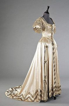 Jeanne Hallée ball or presentation gown, 1903, bodice with reticella style chemical lace, studded with rhinestones and bugle beads, silver lace trim, the skirt with bands of silver lace to the hem, Probably part of the trousseau of Romaine née Stone, daughter of the General Roy Stone, who distinguished himself at the battle of Gettysburg. Romaine married first a fellow American, Laurence Turnure, a banker, at St Paul's Knightsbridge on July 15th 1890.