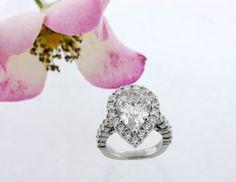 Huge Pear shaped diamond in Halo Setting. #rings #wedding #jewelry www.CostenCatbalue.com