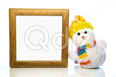 Qdiz Stock Photos   Christmas snowman toy and blank wooden frame,  #backdrop #background #blank #celebration #Christmas #clear #closeup #decoration #doll #empty #eve #figure #frame #fun #funny #greeting #hat #holiday #light #little #Merry #new #scarf #small #snowman #toy #traditional #white #wood #wooden #xmas #year #yellow