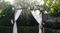 Our timber arch with white lace and pastel flowers for a gorgeous garden wedding ceremony.