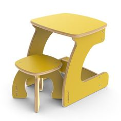 Modern chairs and desks for children using FSC-certified wood.