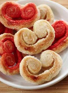 Palmiers or Elephant Ears-Known by all kinds of names - palmiers, palm leaves, elephant ears and French hearts - these sweet French pastries are quick and super easy to make. Just 2 ingredients! Red colored sugar and sweet heart shape makes these a great treat for Valentine's Day or to say I love you to mom on Mother's Day or dad on Father's Day for breakfast or brunch.