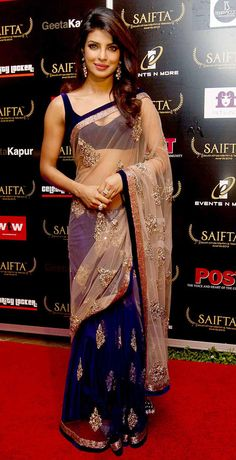 Priyanka Chopra in a Manish Malhotra sari or saree and blouse. She looked stunning in a sheer beige sari embellished with ornate silver embroidery and delicate sequin work Beauty And Fashion, Asian Fashion, India Fashion, Ladies Fashion, Bollywood Saree, Bollywood Fashion, Priyanka Chopra Saree, Kareena Kapoor, Indian Bollywood
