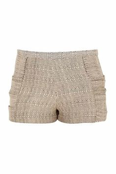 Created in collaboration with a weaving cooperative in Uganda, Study's high-rise shorts are a cool alternative to a classic mini skirt. Team them with tights, and balance the proportions with an oversized sweater for an unexpected fall look.