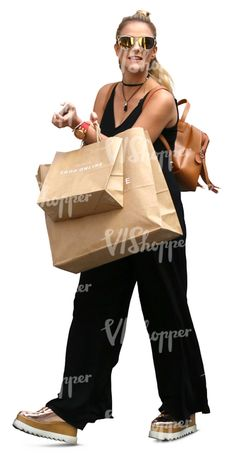 A woman with two big shopping bags walking and smiling