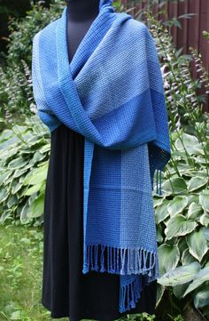 Bluet Shawl: A subtle blend of graduating shades of blues and purples. Length - 83 inches plus fringe. Width - 21 inches Pattern: Huck. Fiber - 80% Cotton and 20% Merino wool. Check website for availability and price.