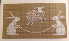 sheep skipping over rabbits holding rope cross stitch