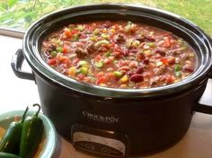 Low Fat Crock pot Taco Soup!! INGREDIENTS-> 1 1/2 cups vegetable broth 1 1/2 lbs boneless skinless chicken breasts 2 (16 ounce) cans pinto beans, rinsed and drained 2 (16 ounce) cans kidney beans, rinsed and drained 1 1/2 cups frozen corn 1 1/2 cups frozen okra 1 (10 ounce) can Rotel tomatoes & chilies 1 (14 1/2 ounce) can Mexican-style tomatoes 2 (14 1/2 ounce) cans no-salt-added diced tomatoes 1 red pepper, chopped 1 green pepper, chopped 2 cups celery, chopped 1 yellow onion, chopped 1 (1...