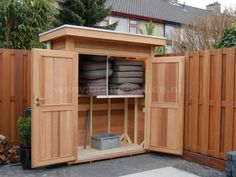 Garden cupboard / garden shed made in cedar with flat roof incl. - Garden cupboard / garden shed made in cedar with flat roof incl. Garden Tool Storage, Shed Storage, Outside Living, Outdoor Living, Patio Cushions, Patio Cushion Storage, Bike Shed, Garden Equipment, Backyard Paradise