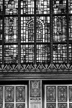 Black and white photograph of the old Alamo National Bank building built 1929 in San Antonio, Texas. This architectural detail photograph focuses on a section of the famous, massive stained glass wind