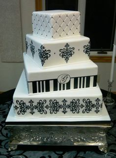 black and white cakes | Lovely four tier black and white damask wedding cake with green satin ...