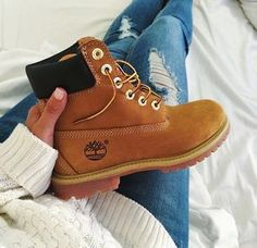 Timberland boots ripped blue jeans white sweather