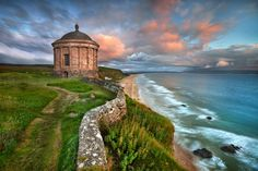 """Mussenden Temple by Stephen Emerson, via 500px - """"Mussenden Temple - Co Londonderry  This is a small circular building located on cliffs near Castlerock, high above the Atlantic Ocean on the north-western coast of Northern Ireland."""" - Another view.  Since I simply could not decide which of the two views was the most wonderful, my only recourse was to include both of them."""