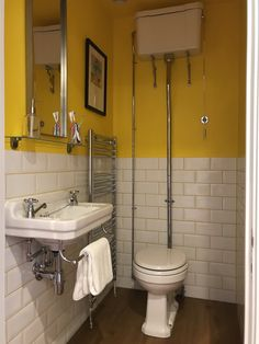 Yellow WC loo with metro tiles with coloured yellow grout. Designed by interior designer Sophie Robinson for DIYSOS in yapton
