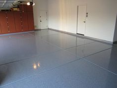 Interlocking garage floor tiles installed in concrete floor