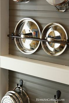 HometoCottage.com cleverly mounted pipes for lids