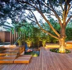 Why cut down a big beautiful old tree when you can build around it? Instant shade/canopy for a cozy deck or patio space. | Via El Blog de Decorador