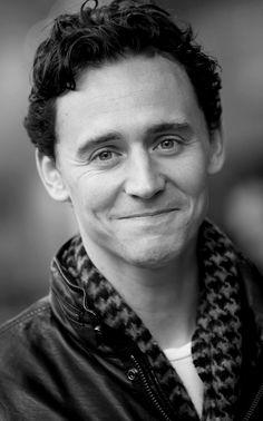 Tom Hiddleston wearing Loki's  scarf :)  He looks so happy.