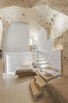 The caves of Matera, also known as sassi, arelocated in southern Italy and have been used since Paleolithic times, when inhabitants began carving out the soft stone to create homes. Tasked with the challenge of creating a warm, inviting interior with a modern feel, local architecture firm Manca Studio, run by brother-sister duo Alfredo and Marina,expertly blended the historic and contemporary for the La Dimora di Metello Hotel. In their first hotel project, they have embraced the curves…