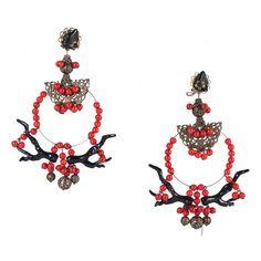 Pendientes de flamenca de gran tamaño de la colección 'Raíces' en tonos corales y negro con botonadura y engarce en bronce envejecido. Uno de los complementos flamenco destacados en nuestra colección.
