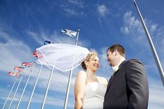 www.photografia.ca  #wedding #photography #portraits #bride #groom #flags #veil #Kingston #Ontario