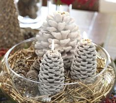 Snowy Pinecone Candles #potterybarncone inspiration  pine  try using powdered sugar and epsom salt for the effect with spray adhesive