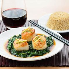A recipe for scallops Hong Kong style. Scallops are seared and served over spinach with a soy-sherry sauce.