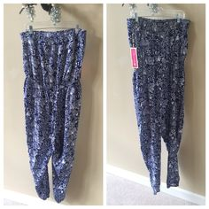 NWT Lilly Pullitzer Upstream Strapless Jumpsuit Brand new. Beautiful. Size XL. I bought it online and accidentally ordered two during the craziness and can't return it. It's still got the tags attached. Lilly Pulitzer Dresses