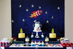 Outer space birthday party dessert table and backdrop! See more party planning ideas at CatchMyParty.com!