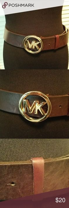 MICHAEL MICHAEL KORS LEATHER BELT Pre owned in good condition but does some light scratches on the leather. Still have the tag. Never worn but stored. 36 in length. The snitches go up to 33 inches. MICHAEL Michael Kors Accessories Belts