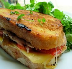 A Grilled Roasted Turkey & Provolone Sandwich.