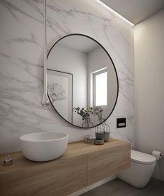 Fugindo do óbvio o espelho saindo do alinhamento com a cuba, permite que a torneira de teto ganhe um destaque especial no ambiente. O…