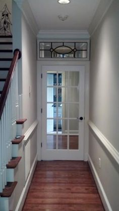 A mirror used above door to look like a transom window.  Clever!