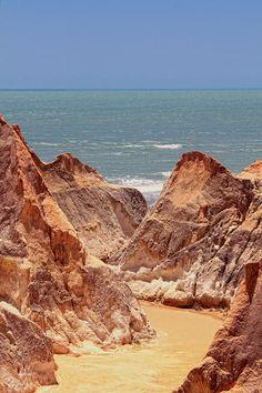 Cliffs of Morro Branco Beach in Beberibe, Ceara State_ Brazil